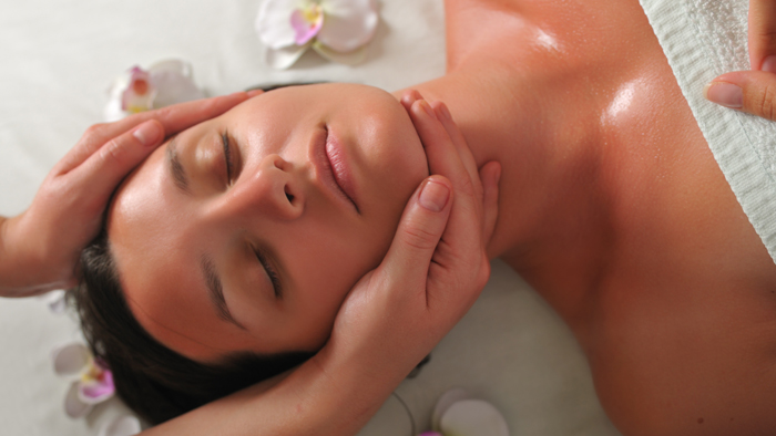 woman having massage at spa and wellness center
